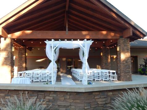 white arbor on the patio